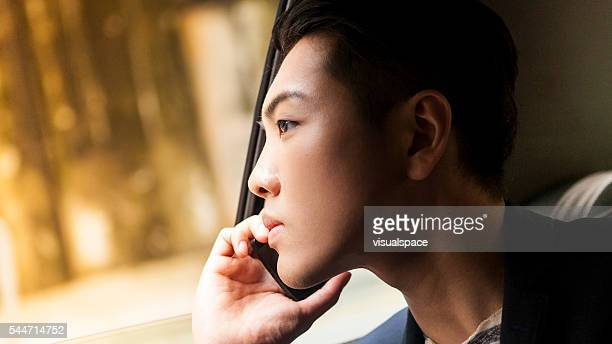 Asian Man Calling From Taxi