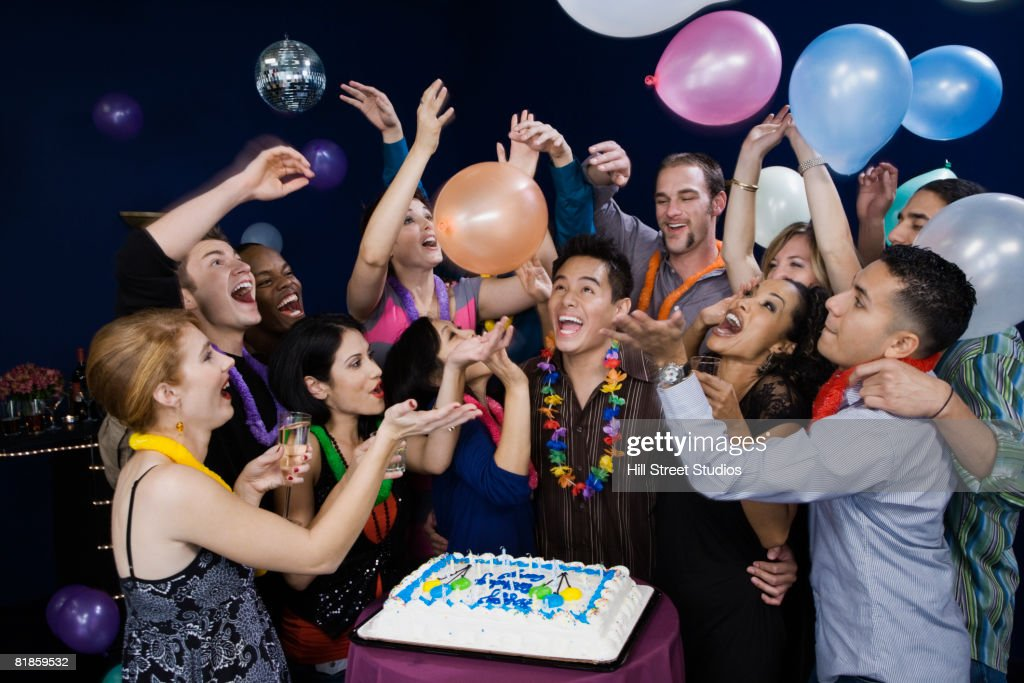 Asian man celebrating birthday with friends : Stock Photo