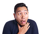 Funny Asian man chocked with tongue out isolated on white
