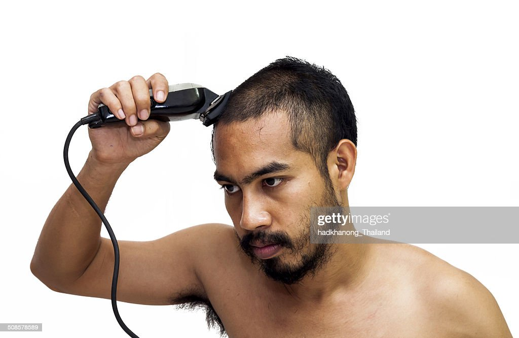 Asian man cut his hair by himself : Stock Photo