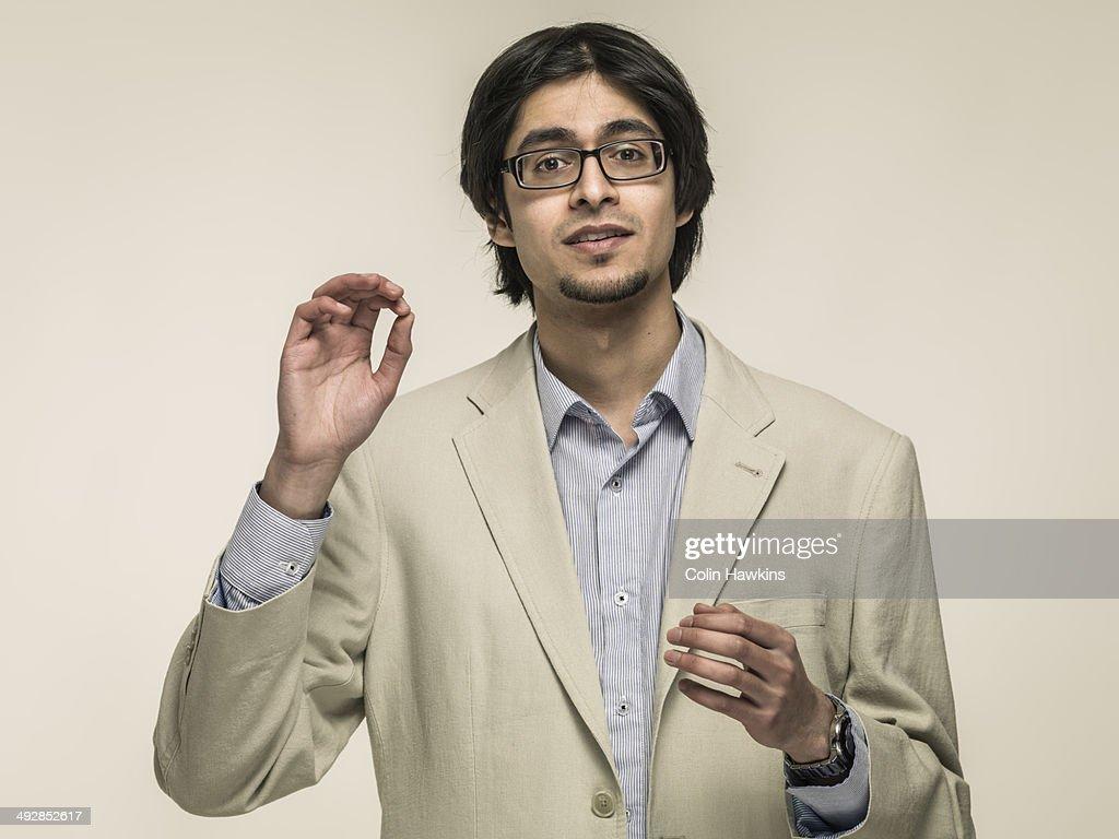 Asian man gesticulating