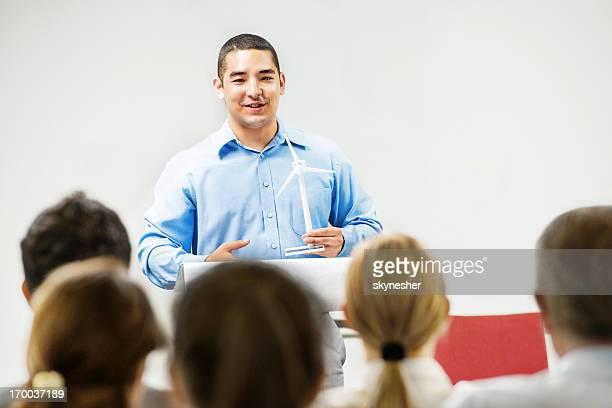 Asian man giving a public speech.