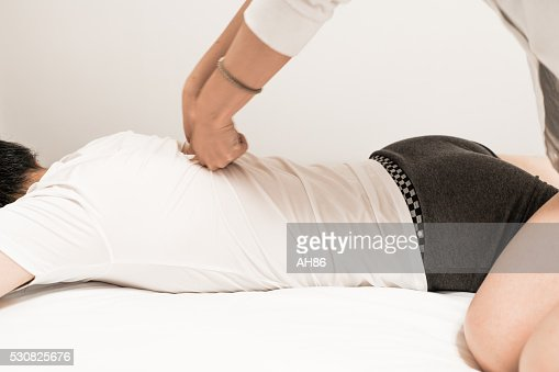 Asian Man Having A Massage Stock Photo