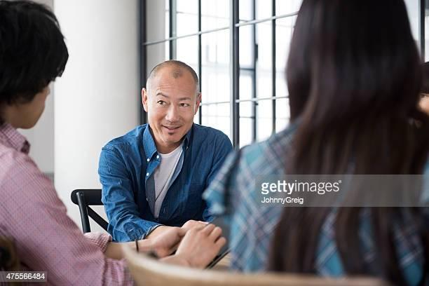Asian man in meeting