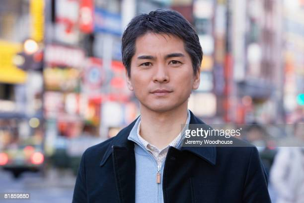 Asian man in urban scene