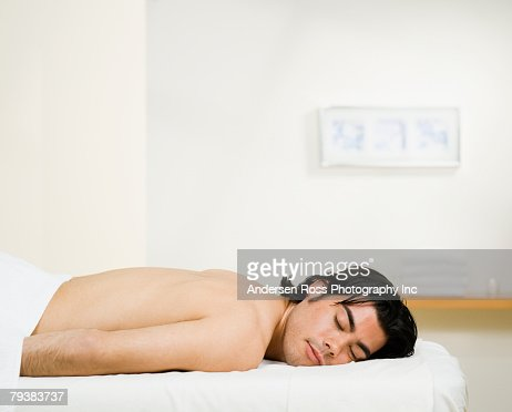 Asian Man Laying On Massage Table Foto De Stock