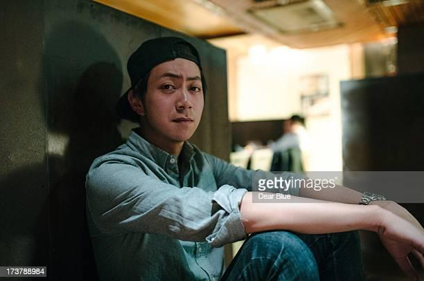 Asian man looking towards camera