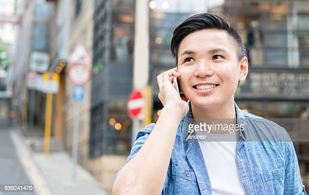 Asian man outdoors on the phone
