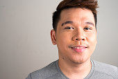 Horizontal studio shot of Filipino man smiling