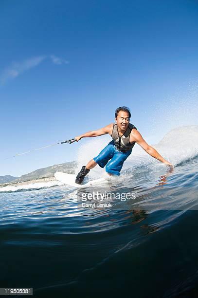 Asian man wakeboarding