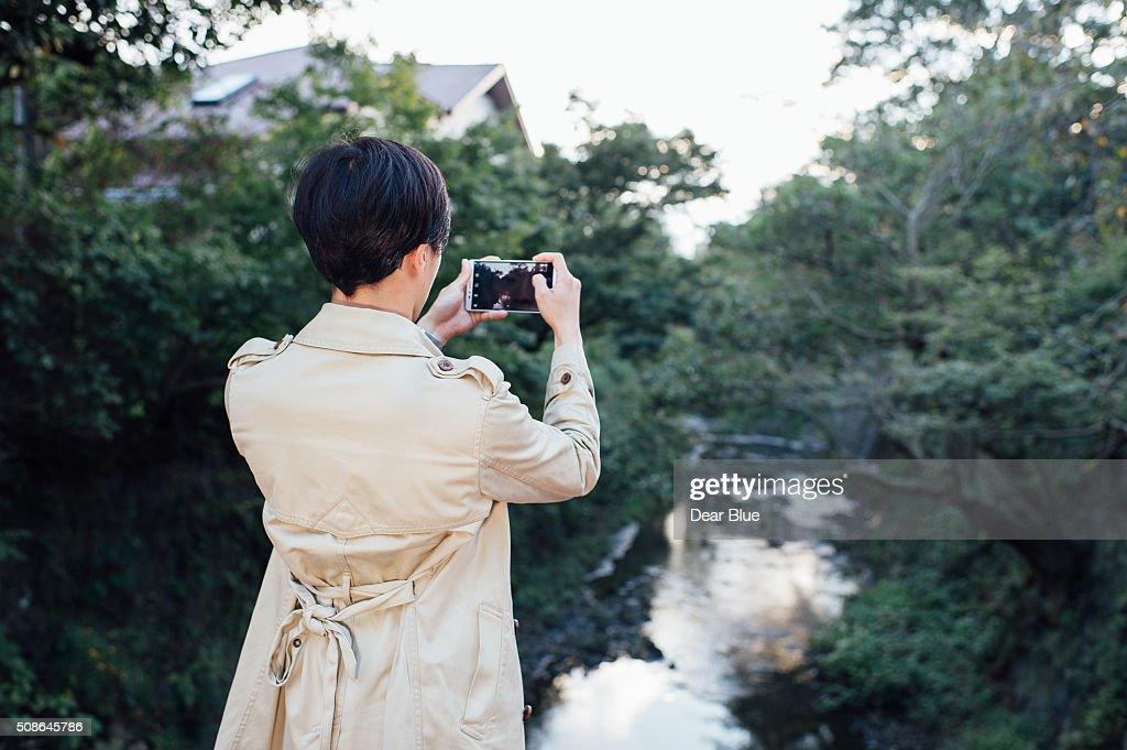 Asian man walking around Kamakura : Stock Photo