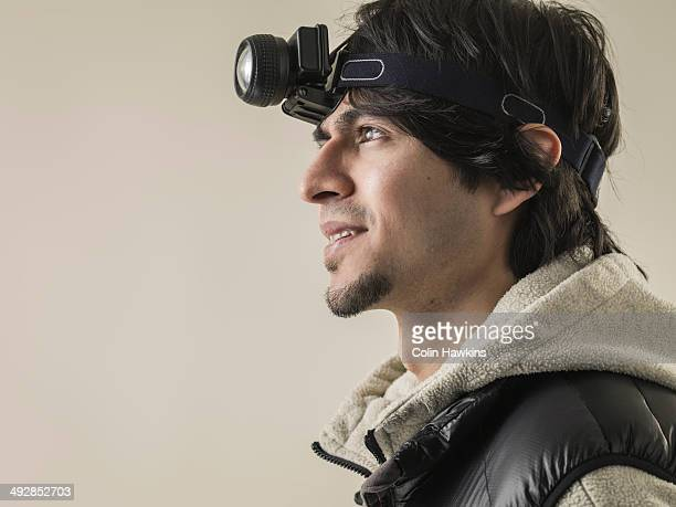 Asian man wearing head torch
