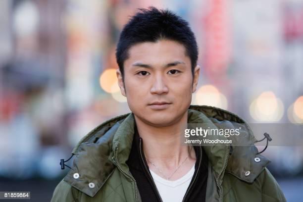 Asian man wearing jacket