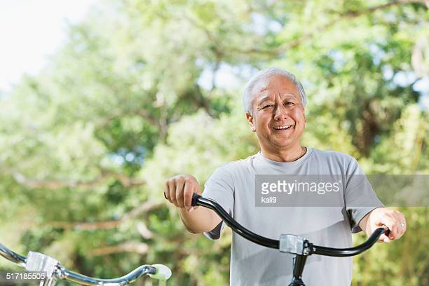Asian man with bicycle