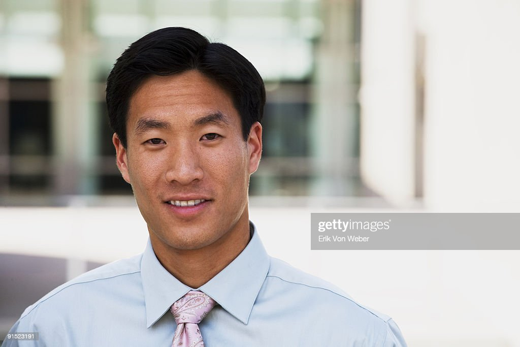 Asian man with tie and dress shirt : Stock Photo