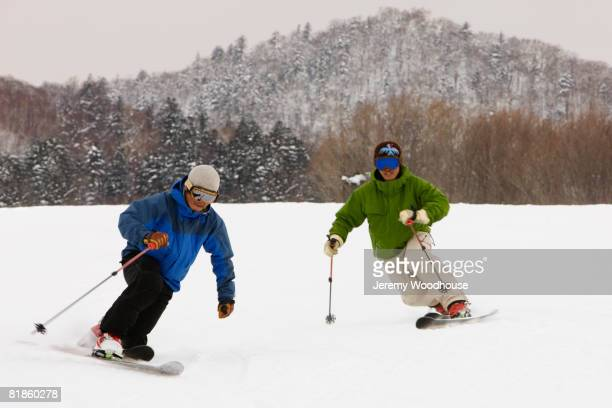 Asian men skiing