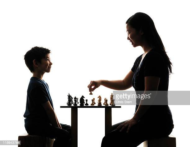Asian Mom and Half Asian Son playing chess