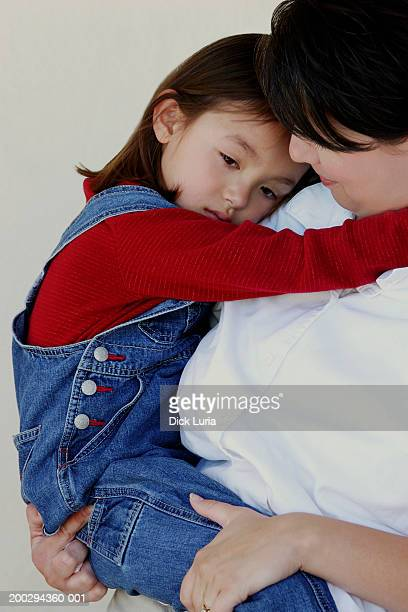 asian mother and baby hugging