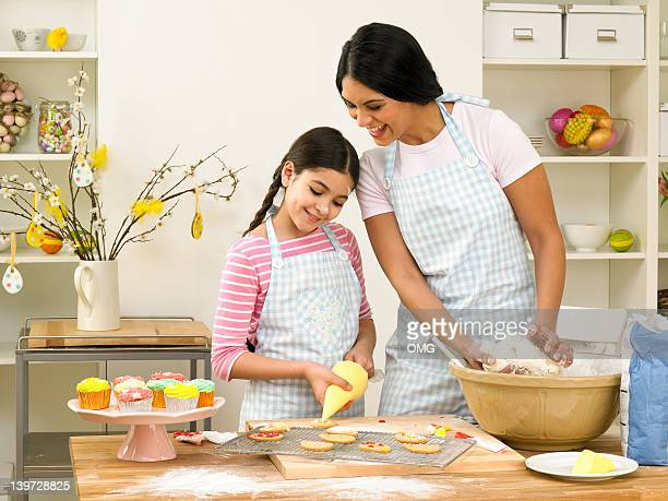 Asian mother and child Easter baking