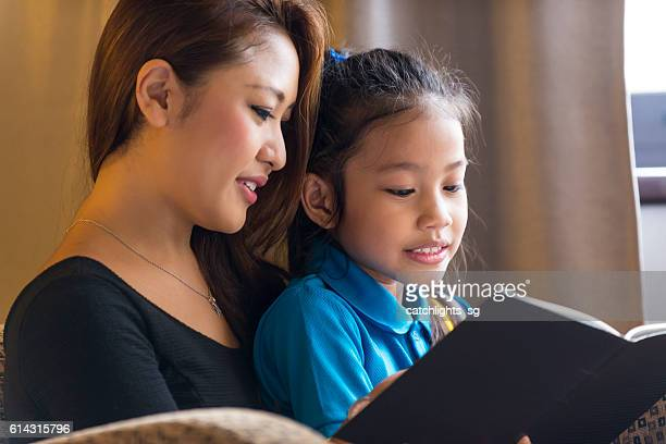 Asian Mother and Child Reading a Book