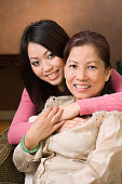 Asian Mother and Daughter, a Loving Chinese, Vietnamese Family Hugging