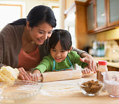 Asian mother and daughter baking together
