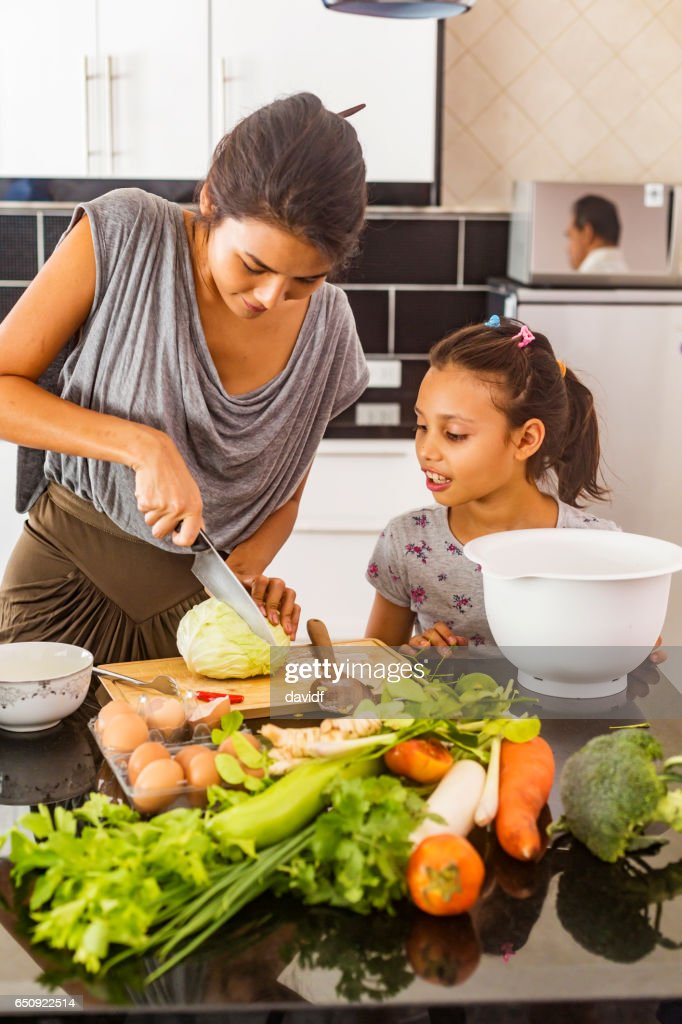 Asian Mother and Daughter Cooking Healthy Food Together : Stock Photo