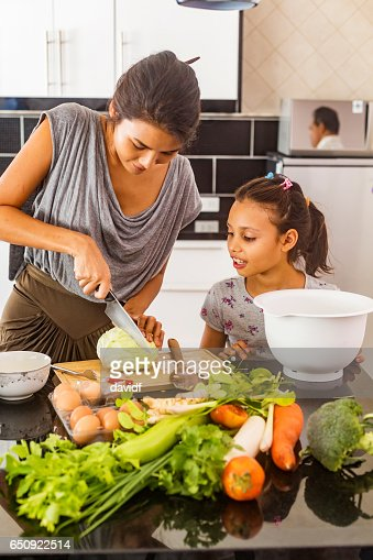 Asian Mother and Daughter Cooking Healthy Food Together : Bildbanksbilder