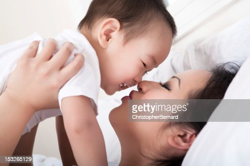 asian mother and son bedroom portrait stock photo getty
