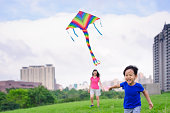 Asian mother and son fly a kite