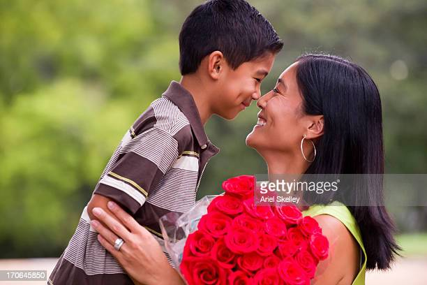 Asian mother and son touching noses