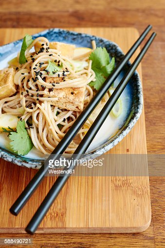 Asian noodle salad with soba noodles, tofu, green onions, yellow ...