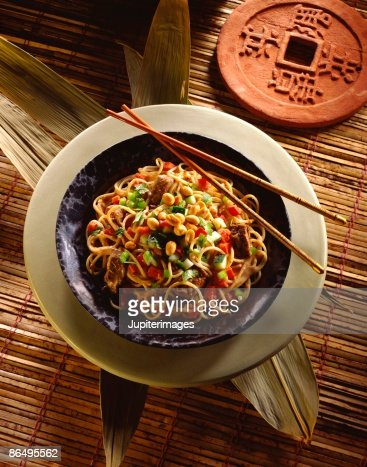 Asian noodles with beef and peanuts : Stock Photo