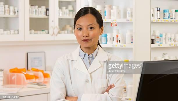 Asian pharmacist standing in pharmacy