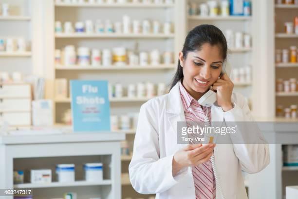 Asian pharmacist talking on phone