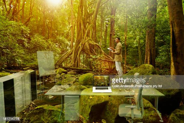 Asian researcher imagining lab in jungle