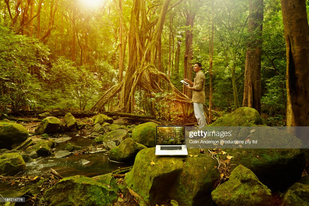 Asian researcher working in jungle