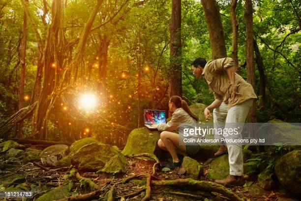 Asian researcher working in jungle