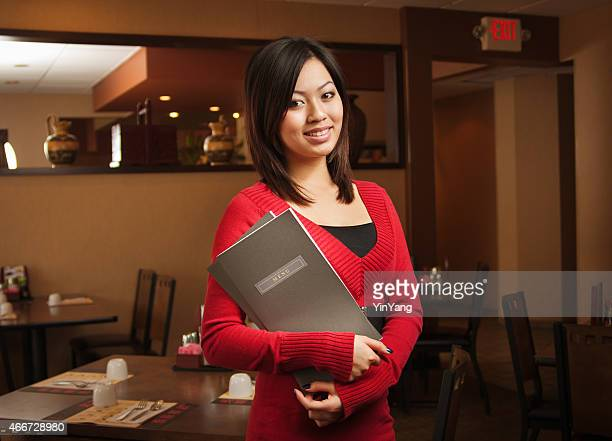 Asian Restaurant Greeting Host or Business Owner Holding Menu, Smiling