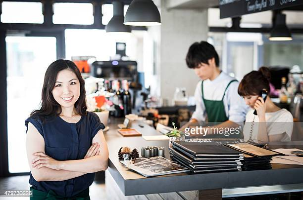 Asian restaurant owner and her employees