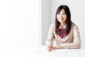 asian school girl studying in room