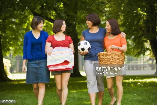 Asian sisters having picnic in park