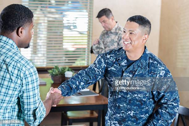 Asian soldier  meeting man in military recruitment office