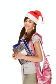 Asian school girl wearing red Santa Claus hat with backpack holding Composition book, notebooks and pen