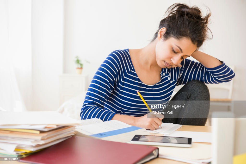 Asian student studying at table