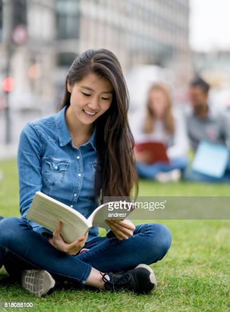 Asian student studying outdoors in London