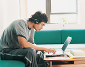 Asian Student Using Laptop at Home
