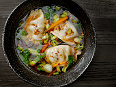 Asian Style Pork Dumpling Soup with Carrots, Bok Choy, Peppers and Green Onion