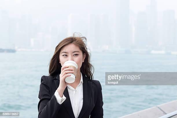 asian successful businesswoman drinking coffee portrait in Hongkong