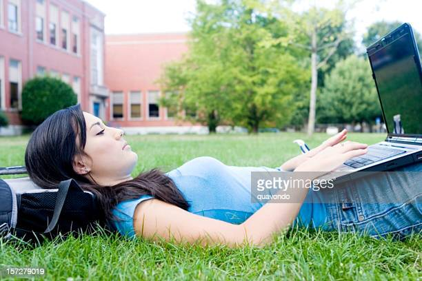 Asian Teenage Girl Using Laptop Outside High School Campus